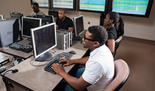 student using a computer at bowie state university