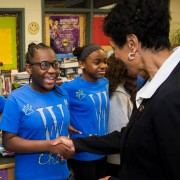 Bowie State University President Aminta Breaux with students at a local school