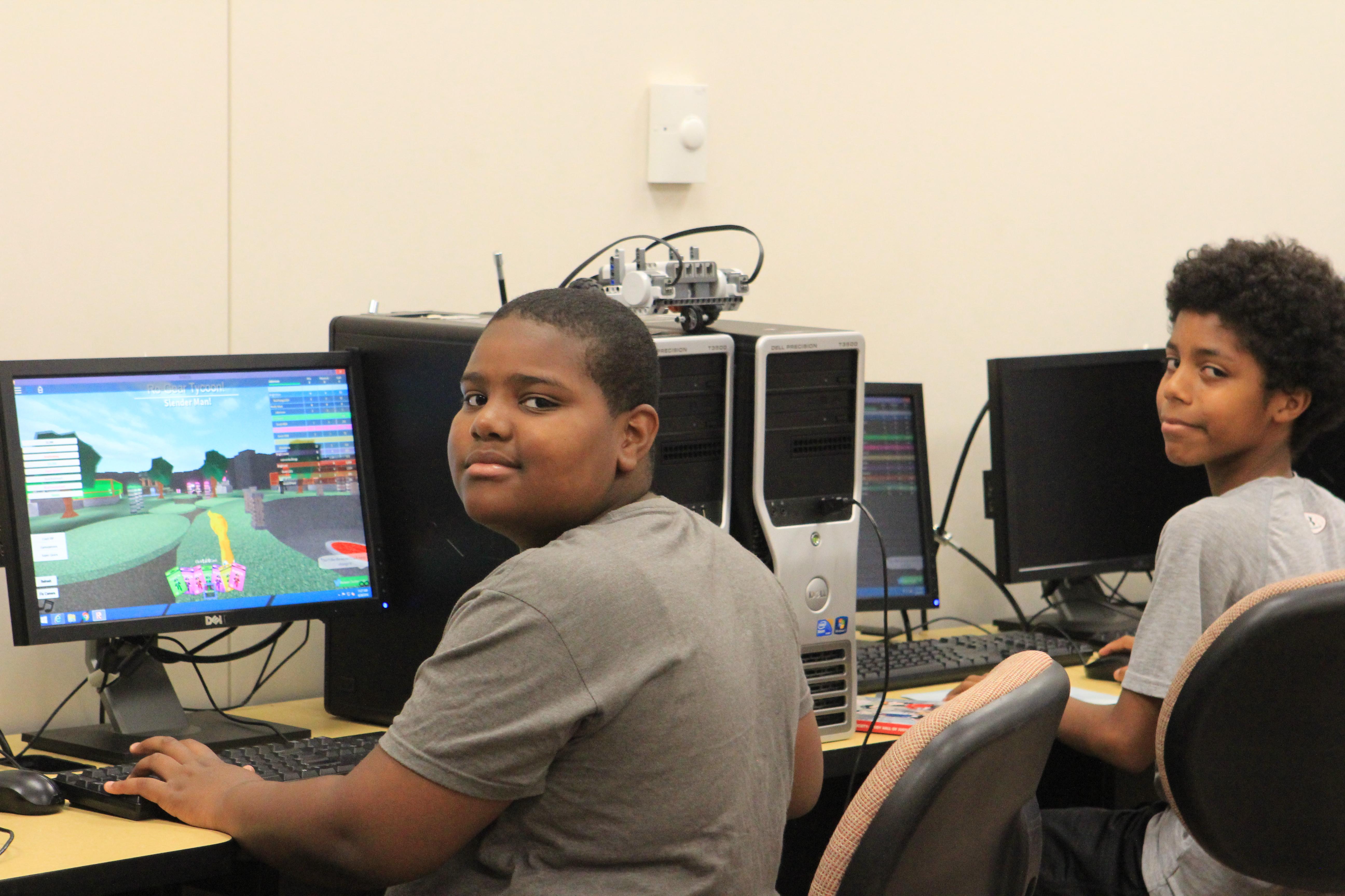 Teen black males working on computers