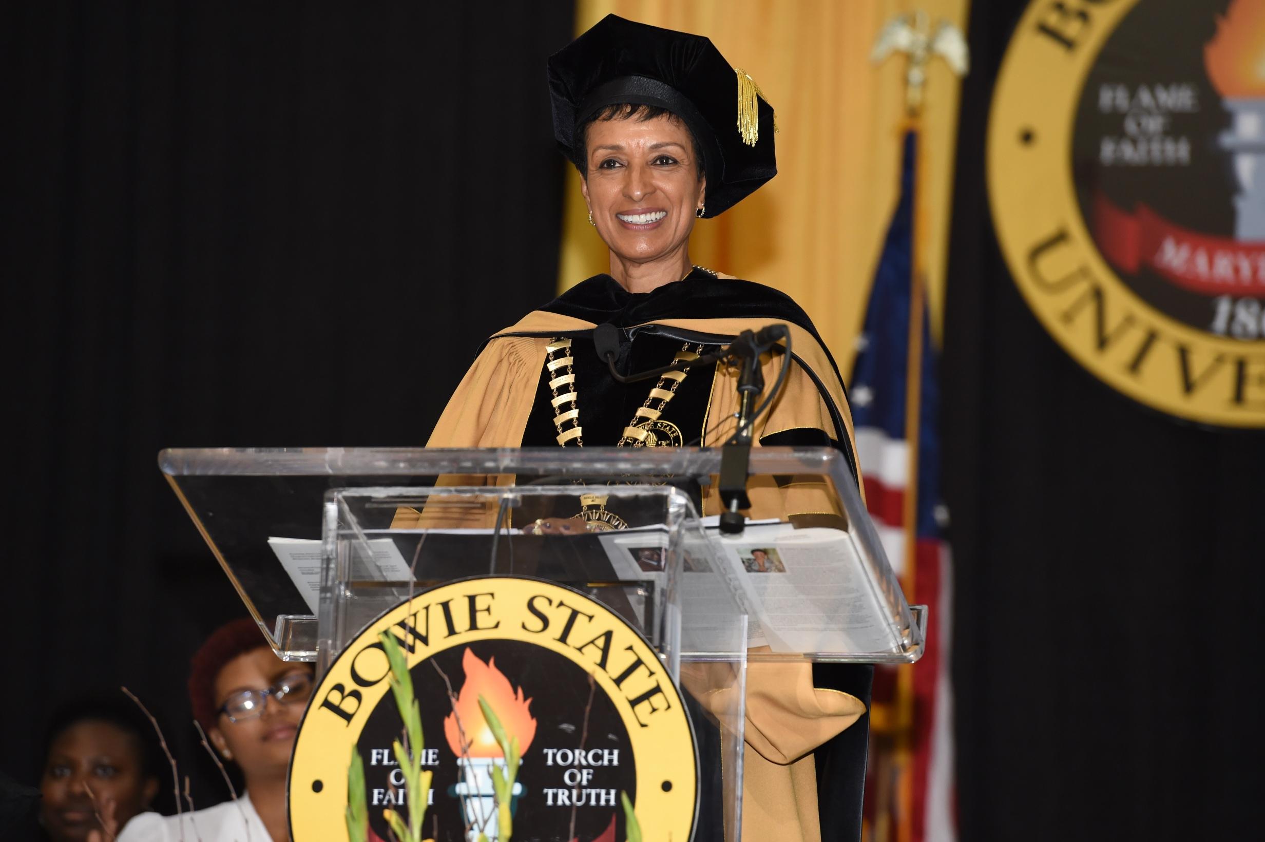 President Aminta H. Breaux wearing regalia
