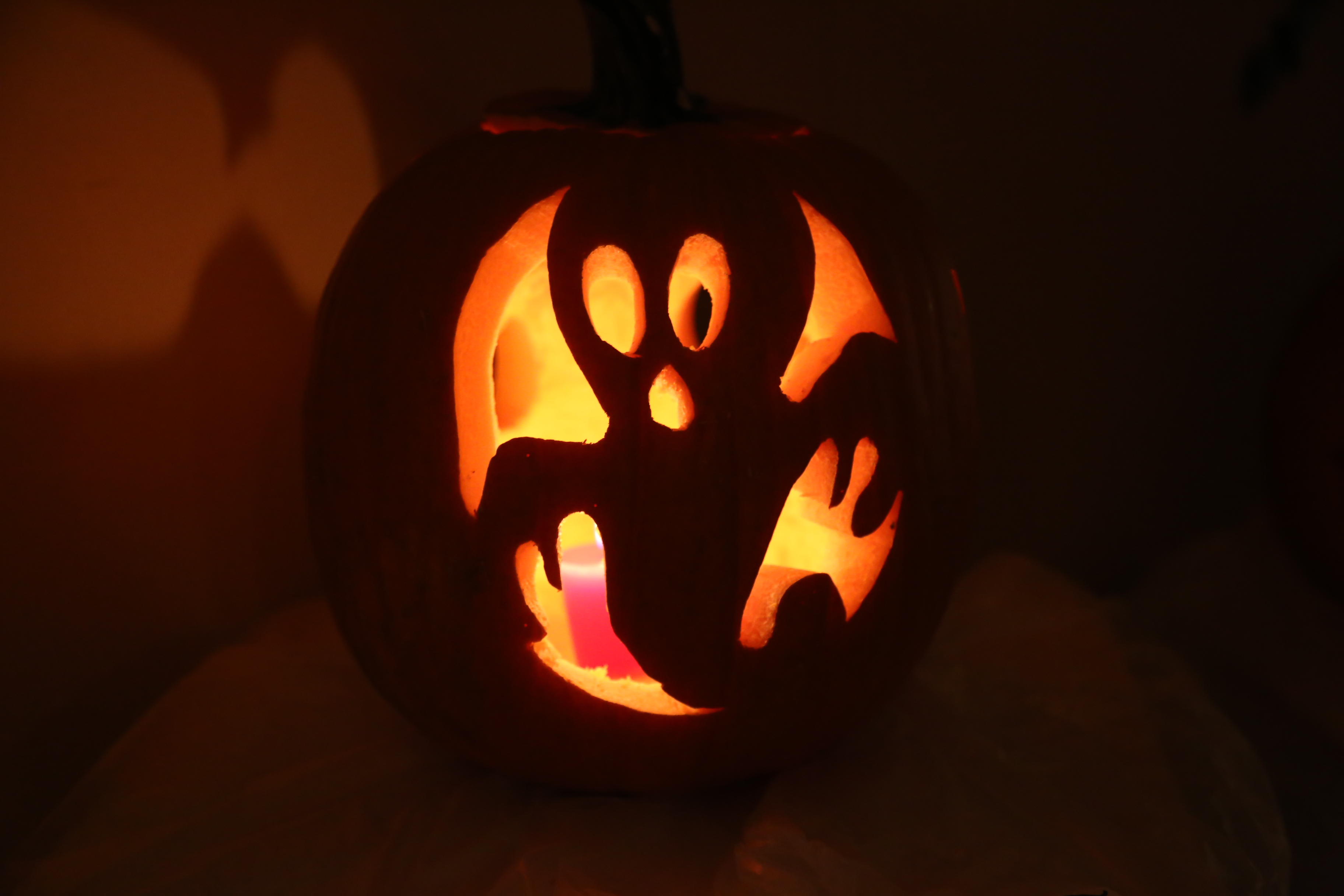 Ghost carved into pumpkin