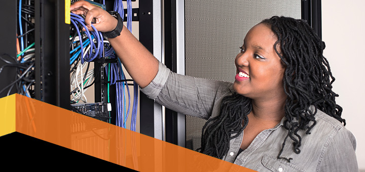 Nichelle Hicks works on a server at Bowie State University