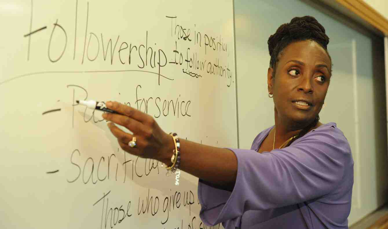 Wendy Edmonds points to a white board where the word Followership and an explaination of it is written